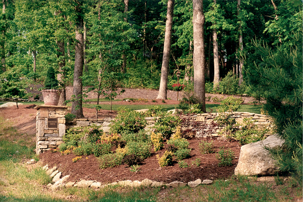 retaining wall and mulched garden